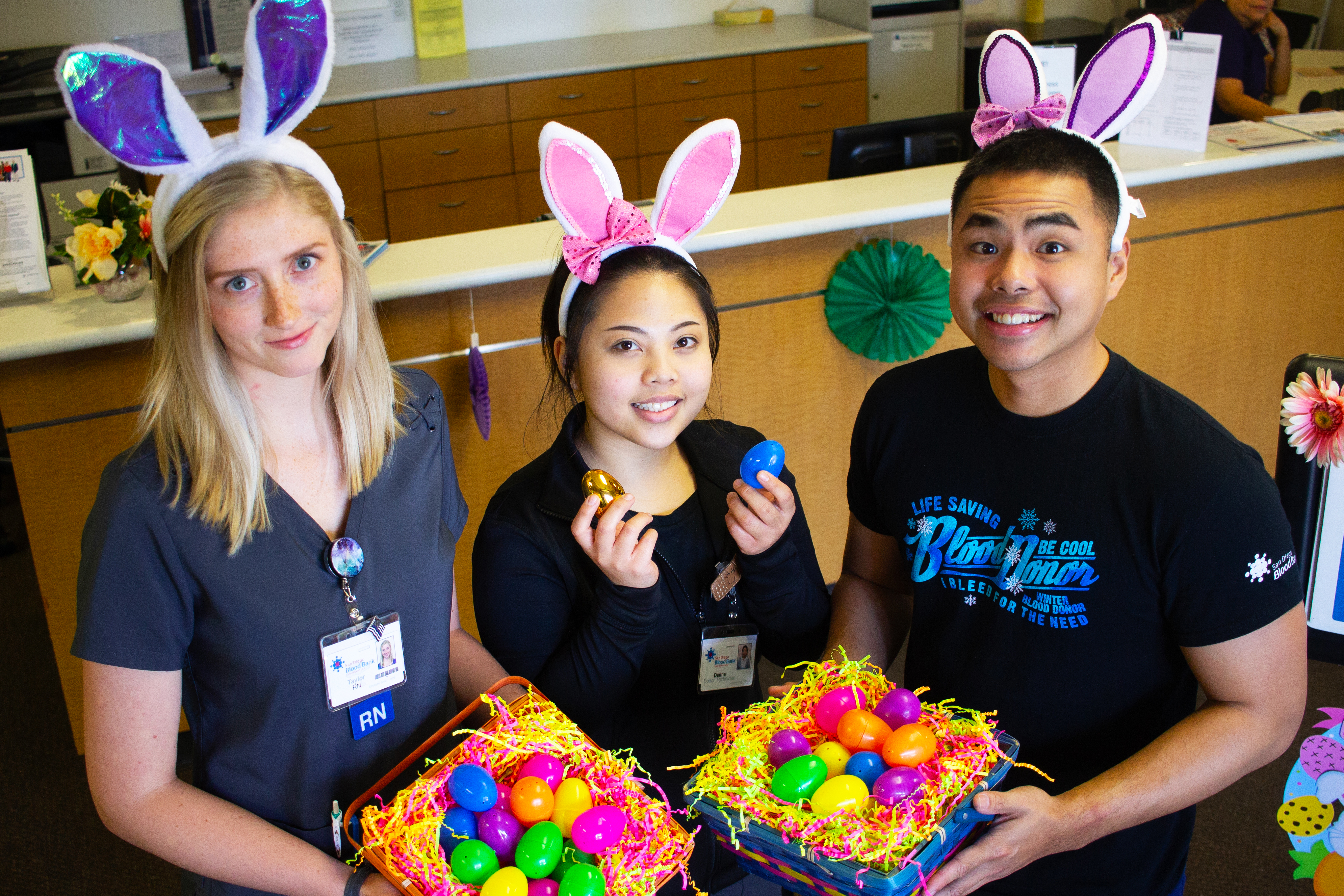 Gateway staff holds easter eggs