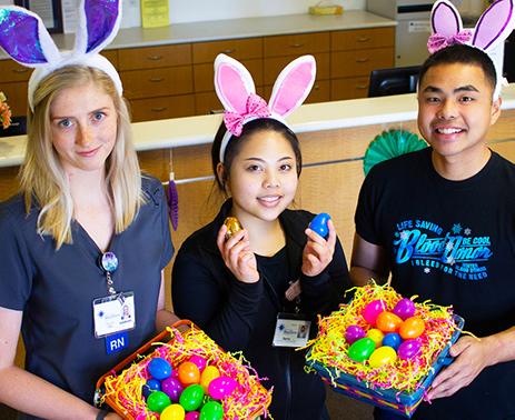 Staff members present easter eggs